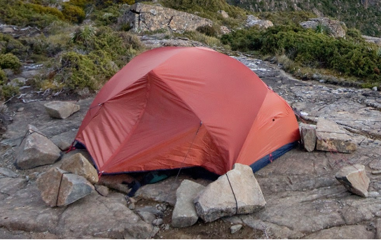 Tent set in rocky area